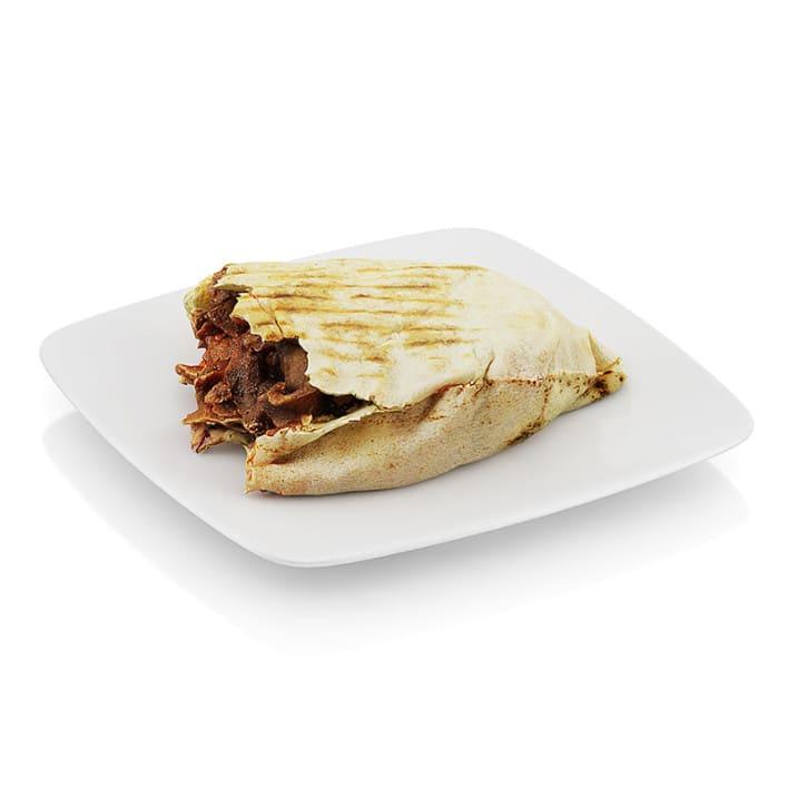 Bitten beef in tortilla