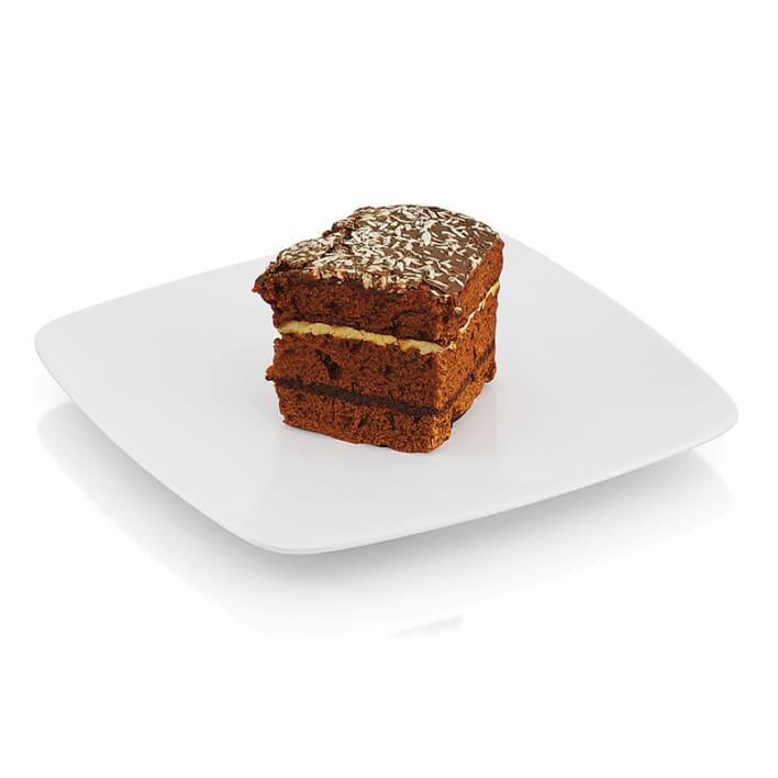 Half-eaten piece of chocolate cake