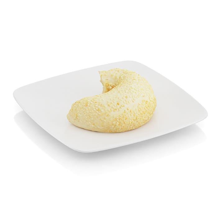 Bitten bagel with sesame seeds