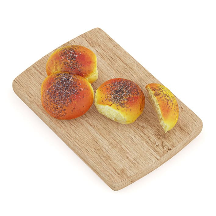 Sliced Bun with Poppy Seeds on Wooden Board